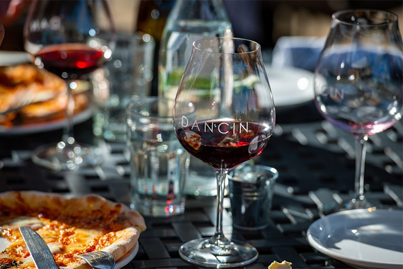 DANCIN wood fired pizza and red wine
